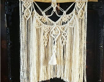 Macrame wall adorned with wooden beads
