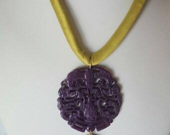 Carved jade necklaces