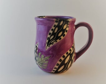 Pottery mug with watercolor effect and  hand carved leaves, sgraffito, mishima
