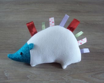 """Stuffed Hedgehog, with labels """"thorns"""" happy baby"""