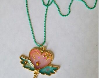 Winged heart bezel necklace