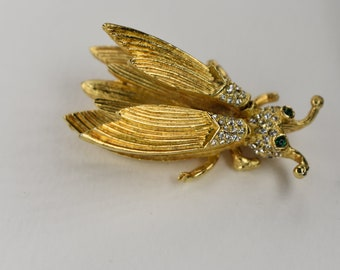 Brooch Hattie Carnegie Fabulous Green Eyed Rhinestone Trembler with Bouncing Wings in a Gold Tone Setting Vintage Costume Jewelry