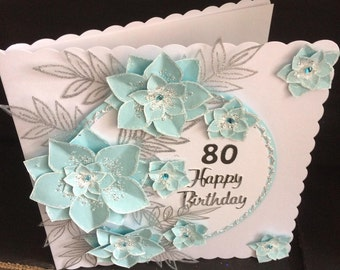 aquamarine flowers on a hand-made birthday card.