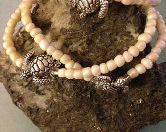 Three Silver plated and glass bead bracelets