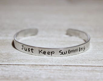 JUST KEEP SWIMMING Cuff Bracelet - Disney Finding Nemo Fan Gift - Stamped Metal Bangle - Dory - One Size Fits All - Made in the U.S.A.