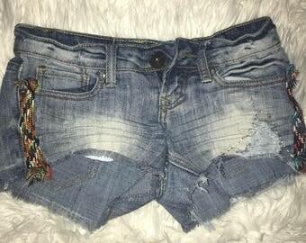 light wash denim shorts with yarn detailing