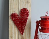 String art on recycled pa...