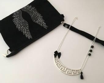 Adorned with silver graphic black bib