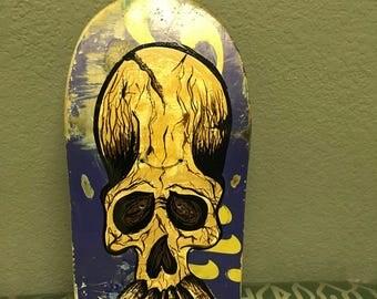 Custom painting on a broken skateboard