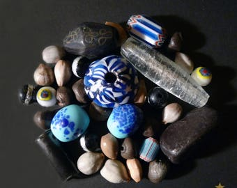 33 beads African glass, wood, seed and terracotta.