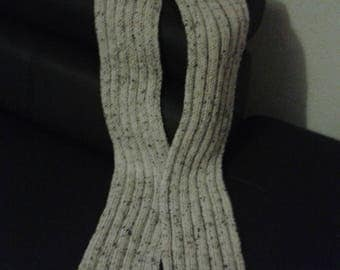 Heathered gray hand knitted wool scarf.
