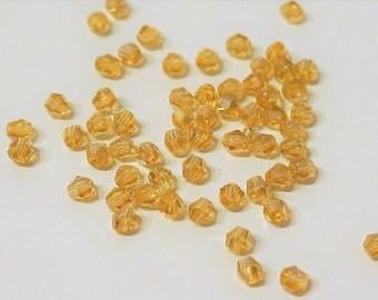 20 top, yellow, transparent, 4 mm glass beads