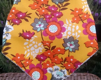 Bright and cheery! Baby Bib with white terry backing and velco fastener.