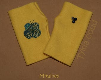 Yellow fleece mittens, asymmetrical, with flowers and bells