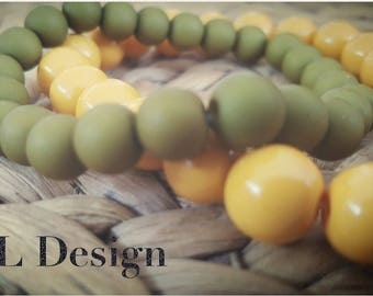 Set of two bracelets green and yellow for woman or man made from high quality glass beads.