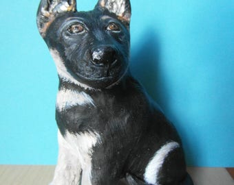 Molded of self-hardening clay German shepherd puppy