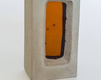 Concrete and glass sculpture