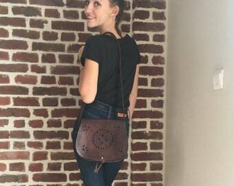 Vintage carved brown leather bag