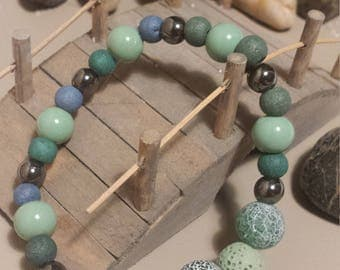 Calming green and blue lava bead bracelet