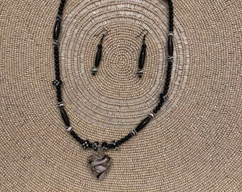 Hand painted heart shaped locket
