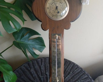 Wood and brass key thermometer/barometer