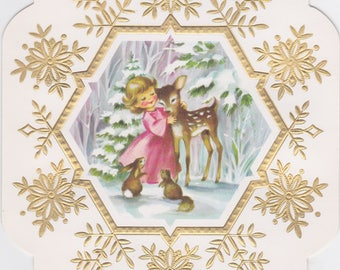 Vintage 1960s card with unusual snowflake shape and design featuring angel with forest creatures