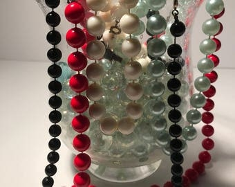 Lot of 4 vintage plastic beaded necklaces from the 70's