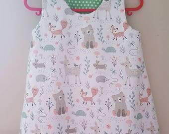 Girls pinafore style dress. Woodland creatures print. Age 1 - 2.