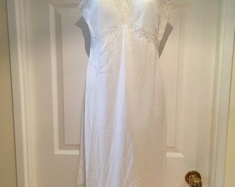 Vintage full slip with pleated breast and bottom, trimmed in lace