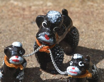 Vintage Mid Century Kitsch Redware Black Poodle Family Chained Poodles Japan