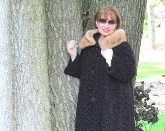 Luxurious vintage 50s black curly lamb, swing style coat with a bell sleeve and blond mink collar. Made by Astrakin in France . Size M.