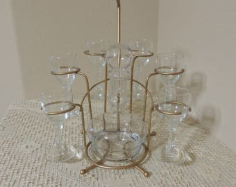 Atomic Eight Piece Set of Glasses with Gold Tone Metal Carrier.  Unusual Metal Rack with Six Glasses and Carafe. Patio or Bar Glassware
