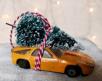 Cool Yellow Car with Tree Strapped to the Top Ornament by Distinguished Flamingo