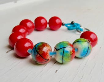 Miro - handmade artisan bead bracelet in red, turquoise and green, with lampwork glass, ceramics and pewter- Songbead, UK, narrative jewelry