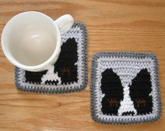 Boston Terrier Cup Coasters. Gray, crochet dog coaster set with peeking Boston dogs. Dog cup cozie