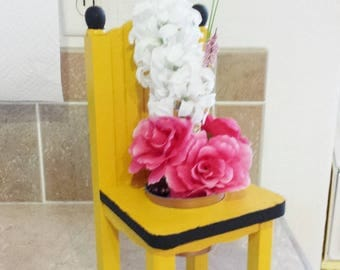 Up cycled vintage mini  wood chair with flower pot and silk flowers.