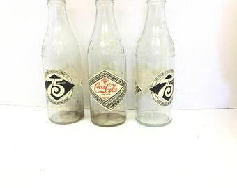 Vintage Coca Cola bottle lot / 75th Anniversary coke / Coca cola memorabilia / Commerative Coke bottles / Embossed / 12 oz bottles / clear