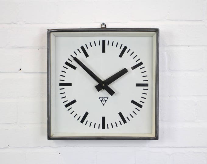 Polished Mid Century Factory Clocks By Pragotron Circa 1960's
