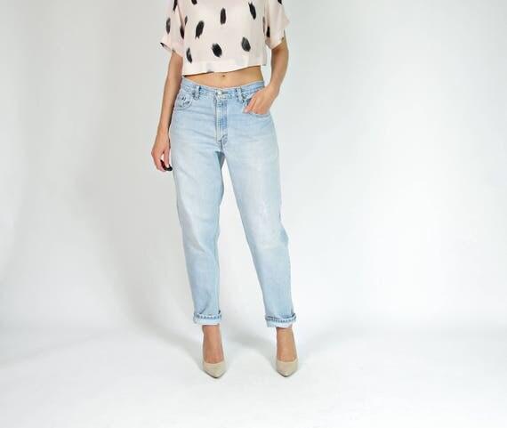90s Levi's 560 light wash denim jeans / size w32 l30