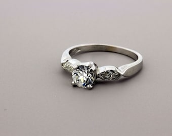 14K Gold Diamond Ring with .65ct Center