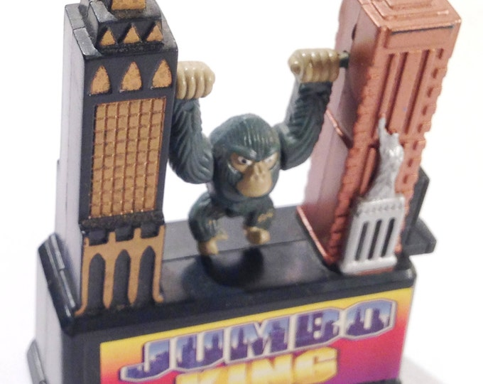 """King Kong """"Jumbo King"""" Vintage 1997 Swinging Toy hangs between the Empire State Building and One of the Twin Towers from Crafts by the Sea"""