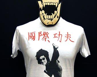 John Cooper Clarke - Post-War Glamour Girl / Kung Fu International - T-Shirt