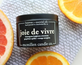 All Natural CITRUS Scented Beeswax Candle in 4 oz black tin (lemongrass, orange, + grapefruit essential oil scented)