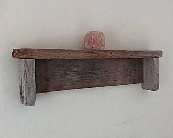 Wall shelf made from driftwood