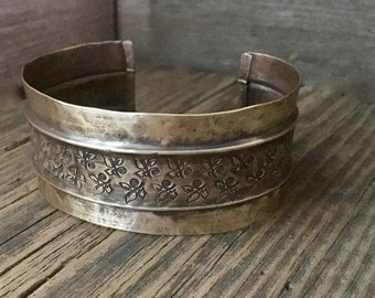 Hammered antique brass cuff, fold formed, floral stamped gold bracelet