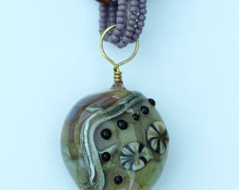 Unique hand made lampwork pendant on a seed bead spiral rope