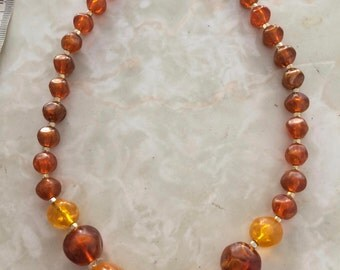 Amber colored plastic beaded necklace - 1960's