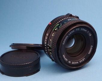Canon FD / nFD 50mm f/1.8 lens + caps