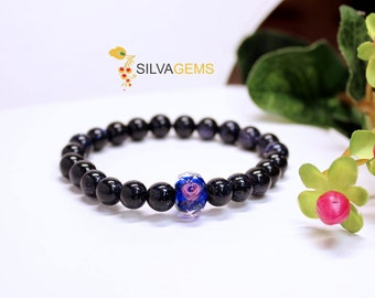 Sparkling Navy Blue Goldstone Gemstone Elastic Bracelet with a Beautiful Royal Blue Rose Glass Bead - Free Delivery. Goldstone Bracelet.