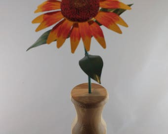 Mexican Sun Flower,a wood flower, hand painted, in a nice turned vase.